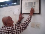 A very old abdi dalem is showing a picture of him when he was still very young.  He has served the kraton for decades.
