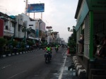 A view of the Malioboro street with a TransJogja bus stop.